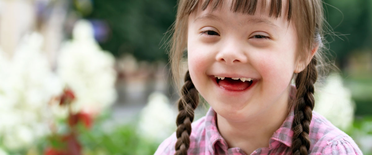 little-girl-with-downs-syndrome-smiling.jpg